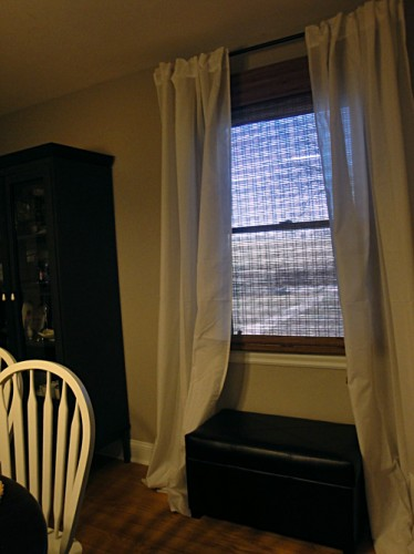 dining room with ikea curtains and overstock roman shades