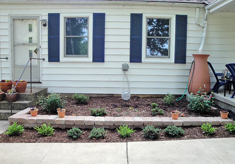 Front flower bed after the hyper house for Flower beds in front of house
